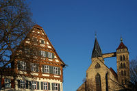 in the foreground a historic half-timbered house - in the background the town church of St. Dionys