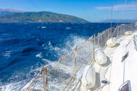 Sailing Yacht and Sea Foam in Windy Day