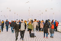 Sopot Pier Molo in the city of Sopot, Poland February 9, 2020. Cold winter day on famous old wooden pier in Sopot, located on Baltic sea. People walking on the longest wooden pier in Europe in Sopot