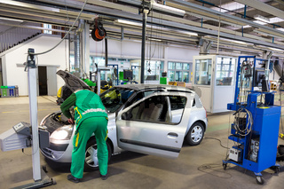 Specialist auto mechanic in the car service, checks the car, engine, engine, carburetor. Concept: repair of machines, fault diagnosis, repair specialist, technical maintenance and on-board computer.