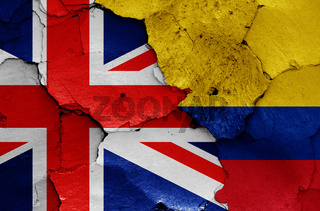 flags of UK and Colombia painted on cracked wall