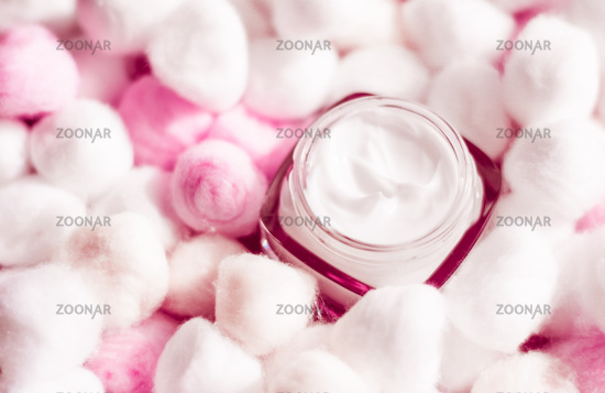 Luxury face cream for sensitive skin and pink cotton balls on background, spa cosmetics and natural skincare beauty brand product