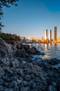 Haeundae beach and Dongbaekseom island at sunset in Busan, Korea