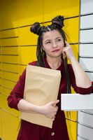 The teenager wonders who could send her such a gift. She tries to guess from whom she received the mail.