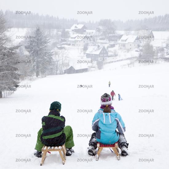 Children at sledding, Schmallenberg, Germany.