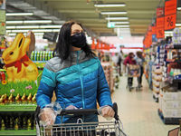 Woman with protective mask during shopping