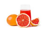 Ripe grapefruits and glass of juice