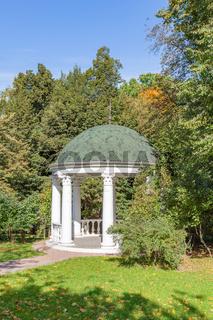 White stone garden house in a summer park