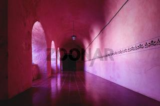 Corridor with decorative border on the wall of the former monestary Convent de San Bernardino de Siena in Valladolid, Yucatan, Mexico