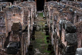 Corridor in the underground galleries of the central arena of the Colosseum in Rome