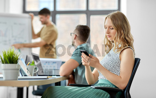 woman with smartphone at office conference