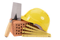 tools and brick as symbol for house construction