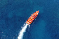Aerial view of a maritime rescue ship sailing in the ocean. High quality photography.