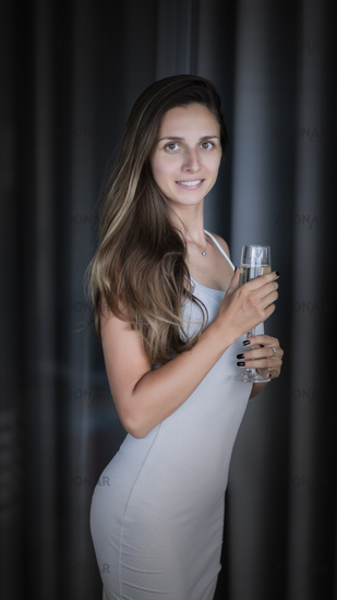 Indoor portrait of a woman with wine
