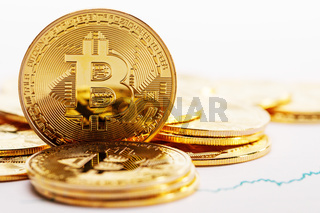 Coins with bitcoin sign and graph
