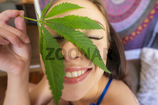 Young Brunette Model Smoking Marijuana