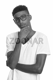 Young handsome African man thinking in black and white