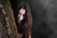 Scary ghost woman, halloween theme. Dark, fear.