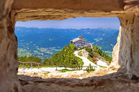 Eagle's Nest or Kehlsteinhaus hideout on the rock above Alpine landscape panoramic view through stone window