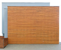 Modern building  wall made from horizontal wooden planks and  gray concrete isolated