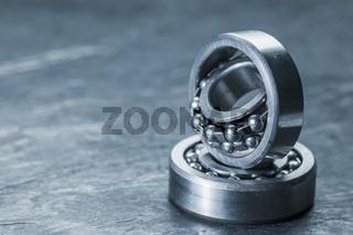 Two spherical roller bearings on slate