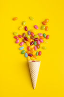 Fruity jellybeans. Tasty colorful jelly beans and waffle cone.
