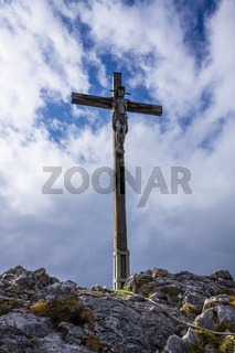 Top and Summit Cross of Mount Kofel, 1342 m in Ammergauer Alps, Ostalpen, located in Oberammergau, Upper Bavaria, Germany
