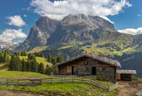 Hut on Seiser Alm, Alpe di Siusi, in front of Langkofel and Plattkofel mountain, South Tyrol