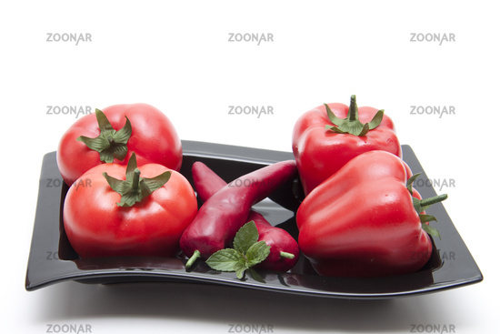 Fresh tomatoes with paprika pods