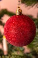 Red Christmas tree ball on a Christmas tree