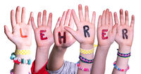 Children Hands Building Word Lehrer Means Teacher, Isolated Background