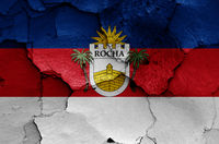 flag of Rocha Department painted on cracked wall