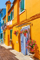Street with colorful houses in Burano in Venice