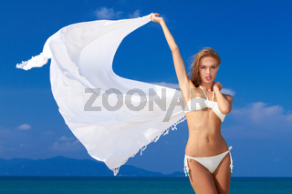 Sexy woman in a bikini with white scarf