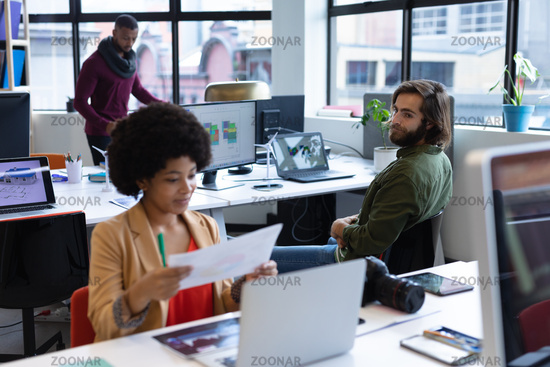 Mixed race businesswoman working in creative office