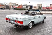 Parade vehicle GAZ 3102 Volga cabriolet at the city square