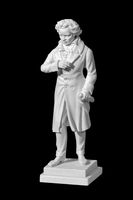 marble statue of a man on a black background