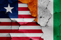 flags of Liberia and Ivory Coast painted on cracked wall