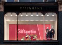 Display of gift ideas in debenhams department store window in Kirkgate leeds