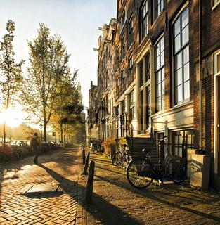 Wonderful street scene at sunset in Amsterdam
