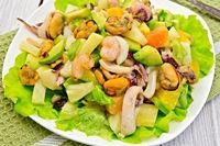 Salad seafood and avocado on light green napkin