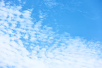 Blue sky with multitude of white clouds