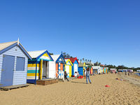 Colourful bathing boxes at Brighton Beach with tourism on vacation under sunlight, Melbourne, Australia, 29 February 2020.