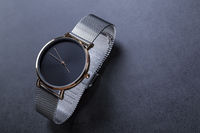 Wrist watch for women on black background