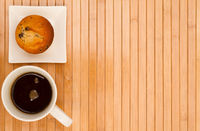 Vanilla with chocolate chips Muffin with a cup of coffee