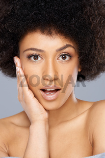 Beautiful surprised African American woman