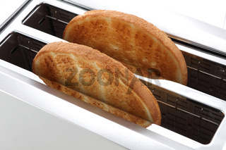 Toast in a toaster two slices golden brown