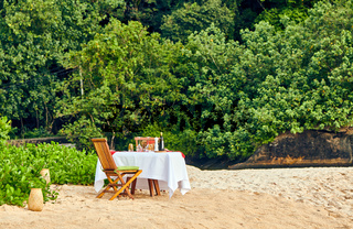 Table set up for romantic dinner on beach at Seychelles