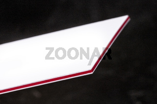 White and red 3-ply thick stock business cards, floating on a black background, a mockup