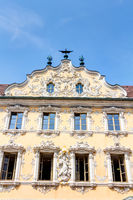 Magnificent building with a rococo facade - Falkenhaus in Würzburg, Oberer Markt